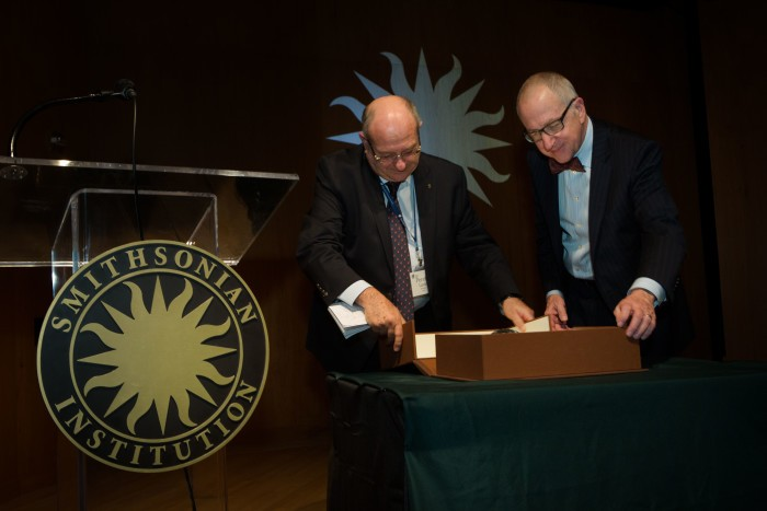 Technion President Prof. Peretz Lavie (left) presents Smithsonian President David Skorton with the Technion Nano Bible