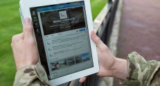 A_serviceman_accesses_social_media_channels_using_an_iPad,_outside_MOD_Main_Building_in_London_MOD_45156049
