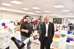 Chinese Minister of Science and Technology Wang Zhigang with Dr. Erez Karpas and Robot Thiago
